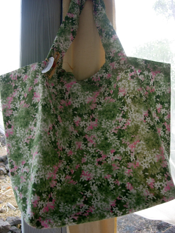 Green and pink floral shopping bag.