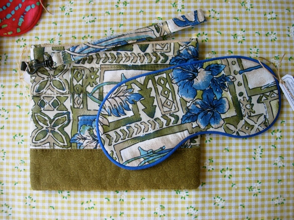 Wristlet purse with travel sleep mask.