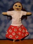 Long ruffled skirt in red floral with long white tee shirt. Shirt is repurposed fabric.