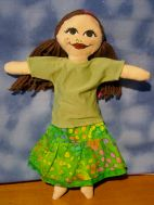 Long ruffled skirt in green-multi batik with long olive green tee shirt. Shirt is repurposed fabric. SOLD