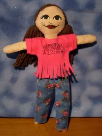 Fringed tee shirt in pink with flowered jeans.